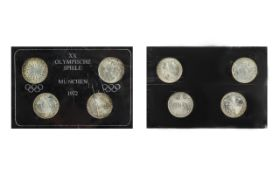 XX Olympic Games Munich 1972 - set of four silver coins in mint condition. Still in original wallet.