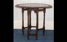 A Carved Oak Drop Leaf Gate Leg Table carved top, turned support.