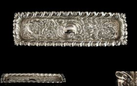 Victorian Period Ornate and Embossed Silver Elongated Pin Tray, Decorated with Images of Flowers,