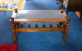 Mahogany Finish Coffee Table Rectangular form, glass topped with cross stretchers and slats,