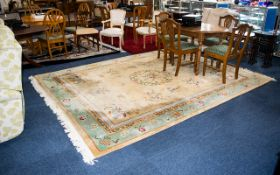 A Large Oriental Wool Rug Cream ground with triple border detail in foliate and Greek key