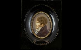 A 19th Century Portrait Miniature Housed in black lacquered frame,