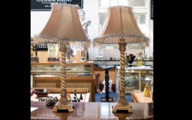 A Pair Of Barley Twist Table Lamps cream ages effect patina, height 28 inches.