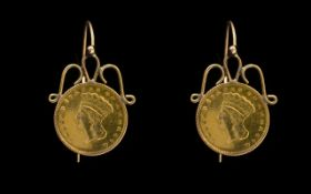 A Pair Of 1862 USA $1 Coin Earrings Wired earrings set with Indian head coins.