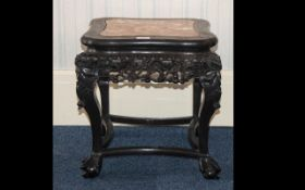 A Chinese Marble Topped Jardiniere Stand - carved hardwood with stretches and apron.