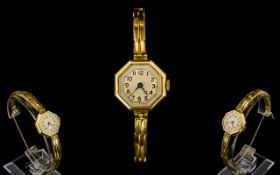 1920's Ladies 18ct Gold Octagonal Shaped Mechanical Wrist Watch with 18ct Gold Integral Bracelet.