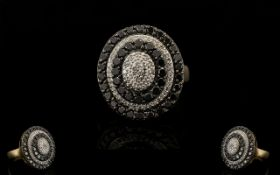 9ct Gold Black and White Diamond Set Cluster Ring - of oval shape in a very attractive flower head