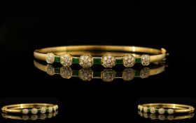 18ct Gold - Attractive Emerald and Diamond Hinged Bangle Set with Six Diamond Flower head Clusters,