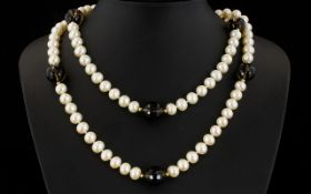 A Cultured Pearl And Topaz Bead Necklace With 14ct Gold Clasp Very long,