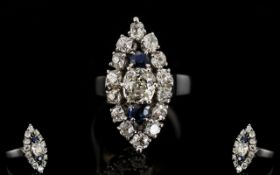 18ct White Gold Marquis Shaped Diamond Cluster Ring The central cushion curt diamond between two