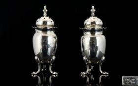 Late Victorian Period SIlver Pair of Pepperettes with Domed Tops and Splayed Feet.