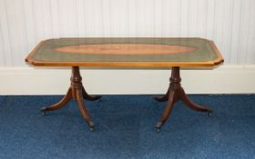 A Large Flamed Mahogany Coffee Table Of rectangular form,