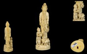 Japanese Very Fine Quality Signed Carved Ivory Figurine (Okimono) In the form of a female deity,