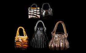 A Collection of Five (5) Decorative Glass Handbags. Assorted styles, in shades of amber and brown.