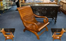 A Contemporary Teak Sleigh Chair Custom made chair of slatted form with scrolling arms and curved