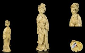 Japanese Very Fine Quality Signed Carved Ivory Figurine (Okimono) In the form of a Geisha in