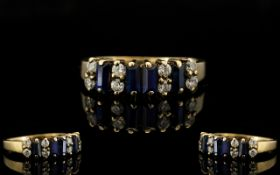 9ct Gold Chanel Set Sapphire and Diamond Ring - of pleasing design/form.