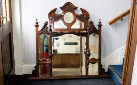 Ornate Over Mantle Mirror fitted with bevelled glass panels,