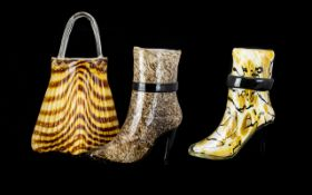 A Collection of Decorative Glassware in the shape of a Large Handbag and Two (2) Boots.