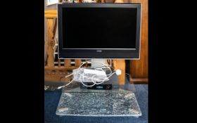 Toshiba Model 32WLT66 Television Complete with glass stand and Sky box.
