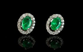 A Pair Of 14ct White Gold Emerald And Di