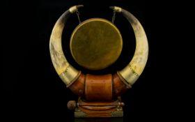 A Golden Oak Table Gong Comprising nicke