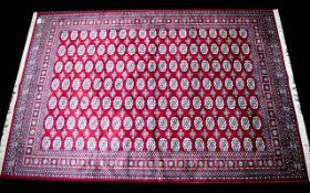 A Large Woven Silk Bokhara Carpet Ornate