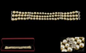 A Triple Strand Pearl Bracelet Comprisin