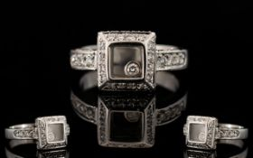 An 18ct White Gold And Diamond Set Chopa