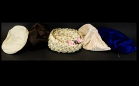 A Collection Of Vintage Hats Five items in total to include woven raffia and grosgrain trim boater