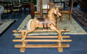 A Carved Wood Rocking Horse Raised on swingstand, carved throughout, height 40 inches,