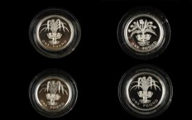 Four Royal Mint Silver Proof One Pound Coins Comprising two x 1985 silver proof piedfort coins.