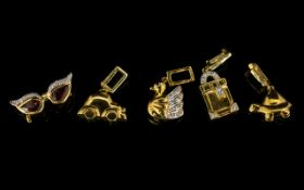 A Collection Of Five 9ct Gold And Diamond Set Charms Each hallmarked to bale, to include swan,