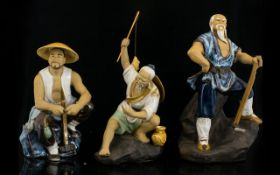 Three Modern Glazed Chinese Figures Each in the form of labourers to include fisherman carpenter