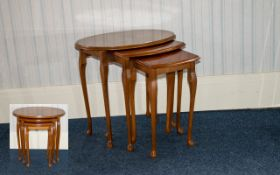 A Nest Of Tables Three oval form tables, each raised on cabriole legs,