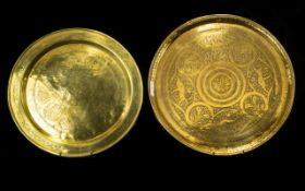 A Pair Of Middle Eastern Brass Chargers Circular form with etched patterning of traditional design,