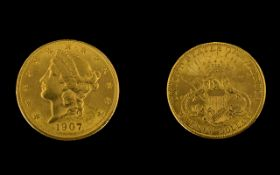 United States Liberty Head 22ct Gold 20 Dollar Coin - date 1907. High grade coin. E. F condition.