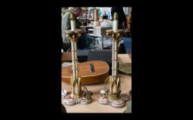 A Pair Of Gothic Style Table Lamp Bases Each raised on quatrefoil base with fleur de lys scroll