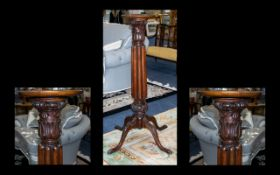 An Early 20th Century Mahogany Torchere Of large proportion raised on trefoil base with acanthus
