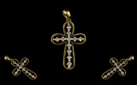 A 9ct Gold Diamond And Diamond Set Cross Set with eleven princess cut diamonds, fully hallmarked,