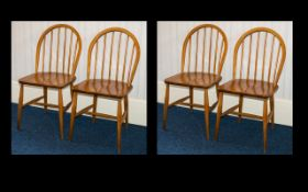 Ercol Four Mid Century Windsor Dining Chairs Of typical form, each with impressed mark to underside,