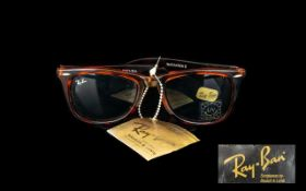 Ray Ban Sunglasses.