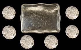 A Large Unmarked Silver Tray Of shaped rectangular form engraved throughout in the aesthetic style,