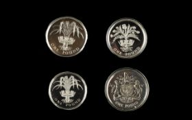 Four Royal Mint Silver Proof One Pound Coins Comprising 1983 and 1985 silver proof piedfort coins.