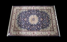 A Very Large Woven Silk Carpet Keshan rug with blue ground and traditional Middle Eastern floral