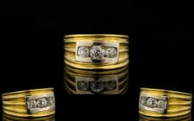 18ct Yellow Gold Contemporary Designed Three Stone Diamond Ring Of solid construct and pleasing,