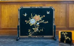 A Black Lacquered Chinoiserie Fire Screen Of traditional form with blossom and birds design with
