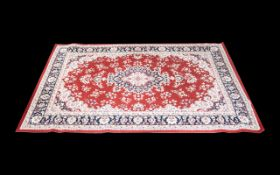 A Modern Persian Style Carpet Poly blend woven rug on red ground with traditional floral and