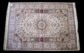 A Large Woven Silk Carpet Keshan rug with beige ground and traditional Middle Eastern floral and