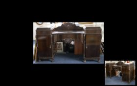 A 20th Century Regency Style Buffet Of very large proportion with central drawer between two